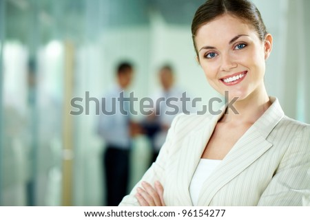 Portrait of a smiling business woman looking confidently at camera - stock photo