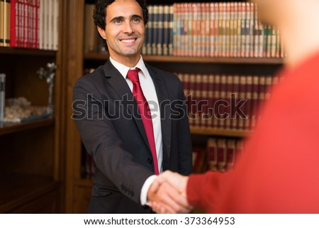 Portrait of a smiling businessman giving an handshake to a customer - stock photo