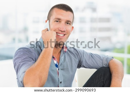 Portrait of a smiling businessman on the phone - stock photo