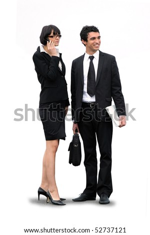 Portrait of a smiling businessman with a suitcase and a businesswoman with a phone - stock photo