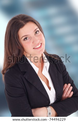 Portrait of a smiling businesswoman. Out of focus background. - stock photo