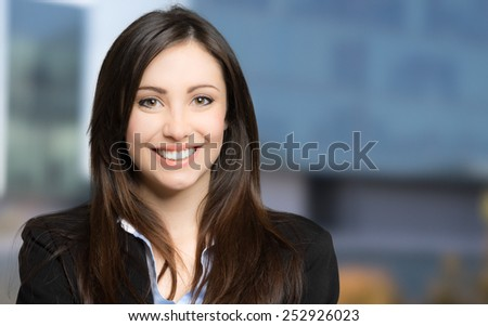 Portrait of a smiling businesswoman outdoor - stock photo