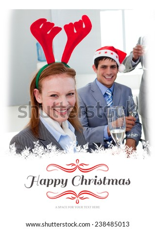 Portrait of a smiling businesswoman toasting with her colleagues against border - stock photo