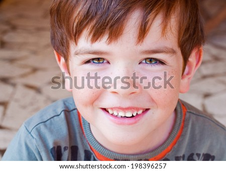 Portrait of a smiling child with freckles - stock photo