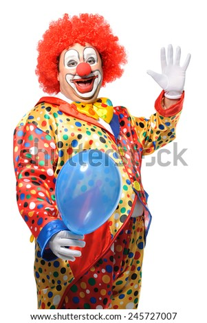 Portrait of a smiling clown with balloon isolated on white - stock photo