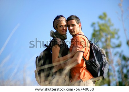 Portrait of a smiling couple of hikers - stock photo