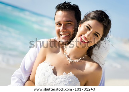 Portrait of a smiling couple sharing a romantic time at the beach - stock photo
