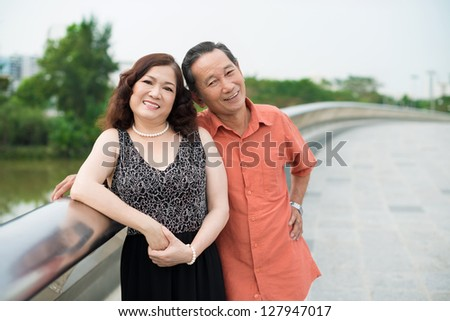 Portrait of a smiling elderly couple posing enjoying a summer day - stock photo