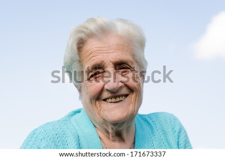 Portrait of a smiling elderly woman - stock photo