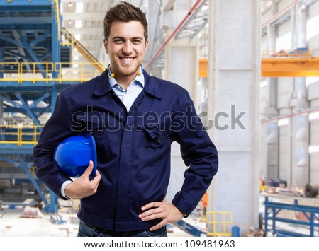 Portrait of a smiling engineer in a construction site - stock photo