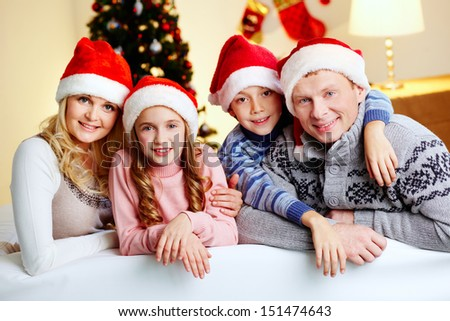Portrait of a smiling family gathering for Christmas celebration - stock photo