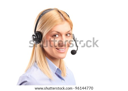 Portrait of a smiling female customer service operator wearing a headset isolated against white background - stock photo