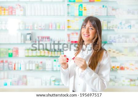 Portrait of a smiling female pharmacist - stock photo