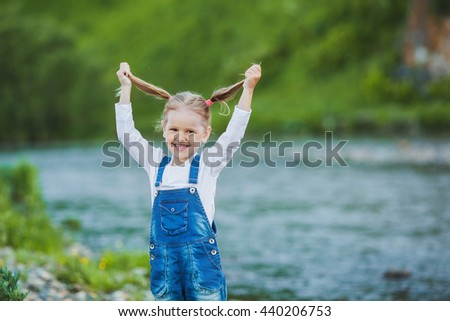 Portrait of a smiling girl, outdoor - stock photo