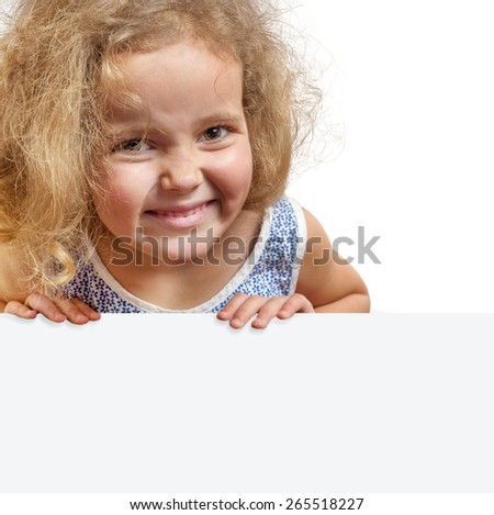 Portrait of a smiling girl with funny ringlets holding white poster isolated against white background - stock photo