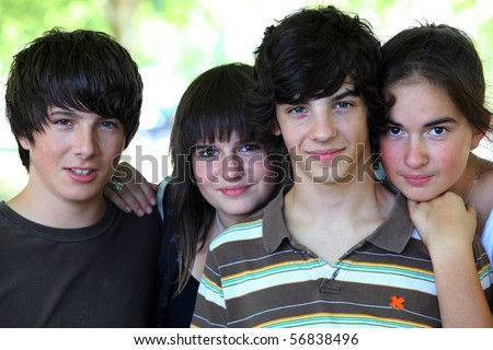 Portrait of a smiling group of teenagers - stock photo