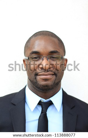 Portrait of a Smiling, Happy, and Attractive, Young Professional African American Businessman Wearing Glasses - stock photo