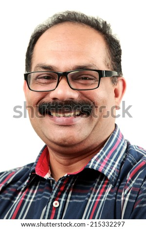 Portrait of a smiling Indian middle aged man - stock photo