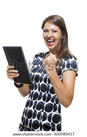 Portrait of a Smiling Lady in an Elegant Printed Dress Holding a Tablet Computer with Copy Space While Looking at the Camera. Isolated on White Background. - stock photo