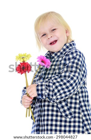 Portrait of a smiling little blond Caucasian girl in autumn coat in a cage, a girl holding in hands during flower-Isolated on white - stock photo