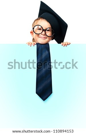 Portrait of a smiling little boy in academic hat and big spectacles holding white board. Isolated over white background. - stock photo