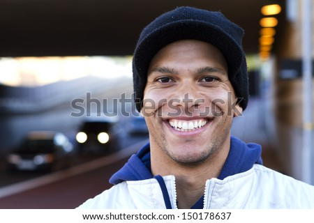 Portrait of a Smiling Man on the Street - stock photo