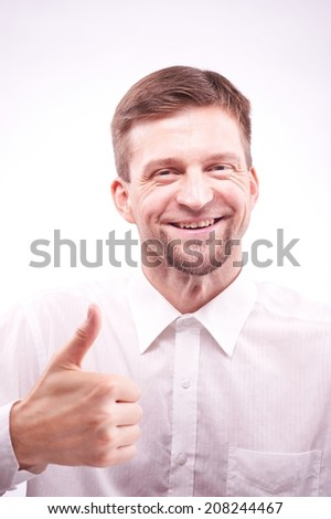 Portrait of a smiling man shows like - stock photo