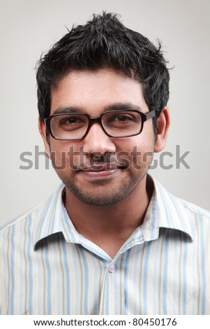 Portrait of a smiling man wearing spectacle - stock photo