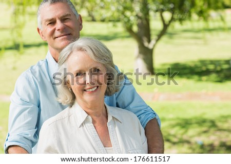 Portrait of a smiling mature couple at a summer park - stock photo