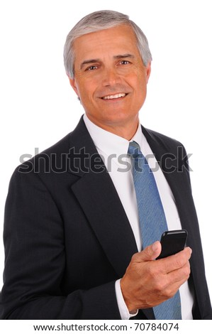 Portrait of a smiling Middle Aged businessman with cell phone on a white background - stock photo