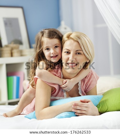 Portrait of a smiling mother and child  - stock photo