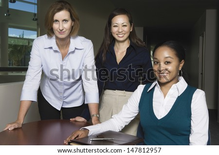 Portrait of a smiling multiethnic group of businesswomen - stock photo