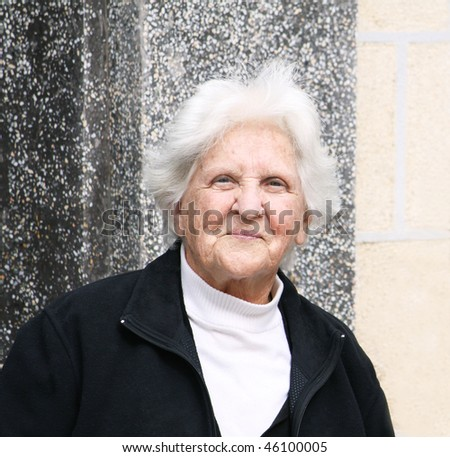 portrait of a smiling old caucasian woman - stock photo