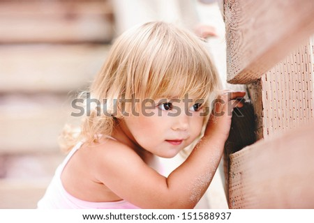 Portrait of a smiling pretty little girl closeup - stock photo