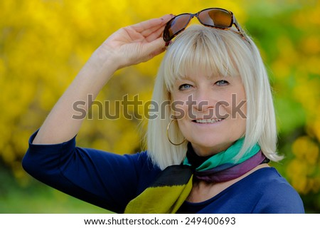 Portrait of a smiling senior woman under his glasses - stock photo