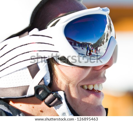 Portrait of a smiling skier woman with helmet - stock photo