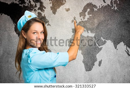 Portrait of a smiling stewardess in front of a world map - stock photo