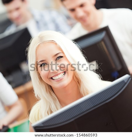 Portrait of a smiling student in computer science class. - stock photo