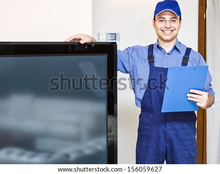 Portrait of a smiling television technician - stock photo