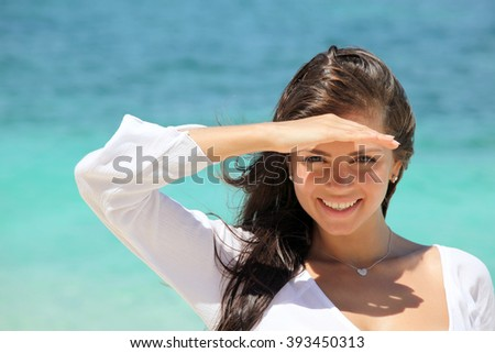 Portrait of a smiling woman at seaside - stock photo