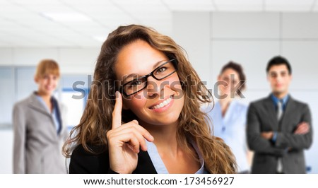 Portrait of a smiling woman holding her eyeglasses - stock photo
