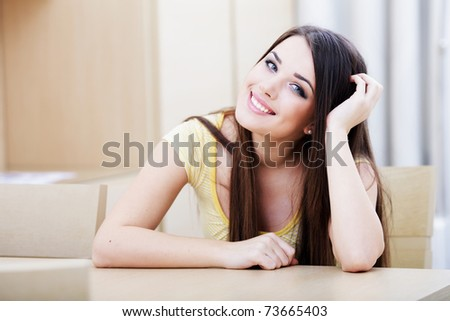 Portrait of a smiling woman resting at home - stock photo