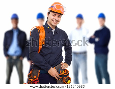 Portrait of a smiling worker in front of his team - stock photo