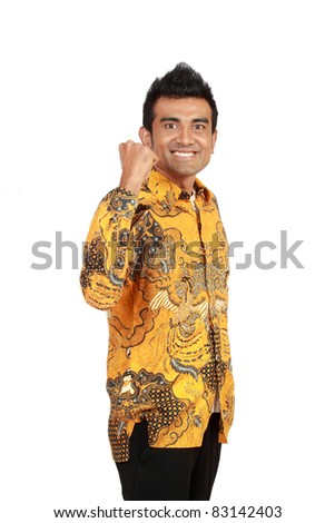 Portrait of a smiling young asian businessman standing against white background - stock photo