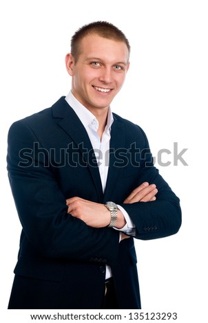 Portrait of a smiling young businessman standing against isolated white background - stock photo