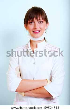 Portrait of a smiling young doctor - stock photo