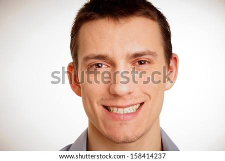 Portrait of a smiling young man close up - stock photo