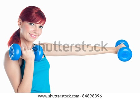 Portrait of a smiling young woman exercising with dumbbells, isolated on white, studio shot - stock photo