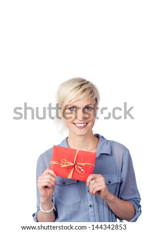 Portrait of a smiling young woman holding gift coupon against white background - stock photo