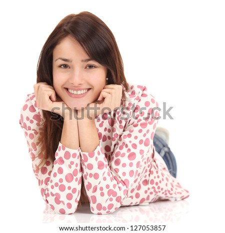 Portrait of a smiling young woman lying on the floor isolated on white background - stock photo
